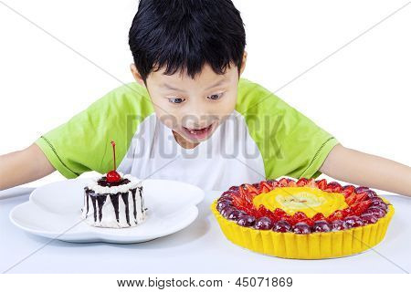 Excited Boy Looking At Colorful Desserts