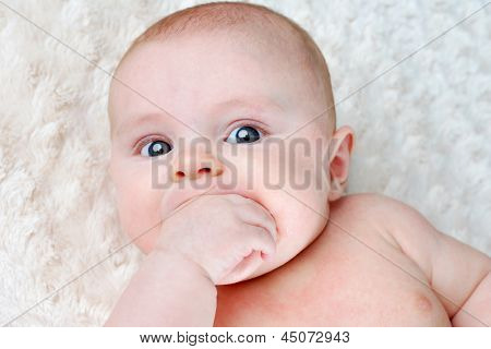 Baby Sucking On Its Hand