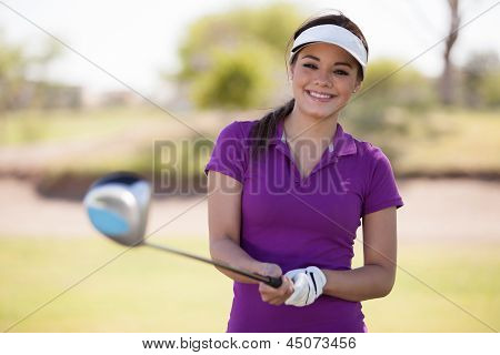 Happy golfer ready to play