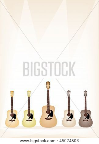 Five Earth Tone Guitars On Brown Stage Background