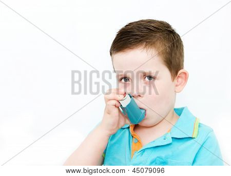 Little Boy Using His Asthma Pump