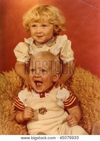 Vintage photo of siblings (early eighties)