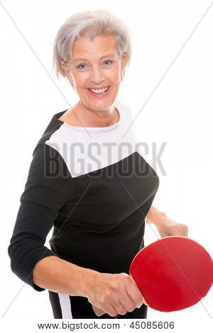 Active senior woman playing table tennis in front of white background