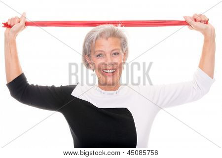 Senior woman with rubber band in front of white background