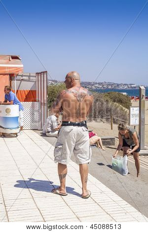 Man With Tattoos On Back