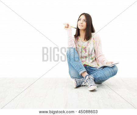 Beautiful Girl Teenager Thinking Sitting On Floor.