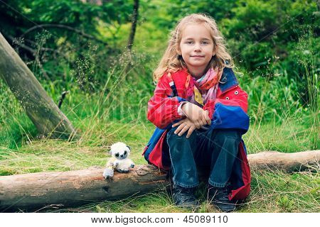 Little Girl Sitting On A Bough