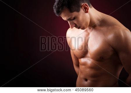 Healthy muscular young man with beautiful six pack