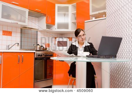 Businesswoman In Kitchen