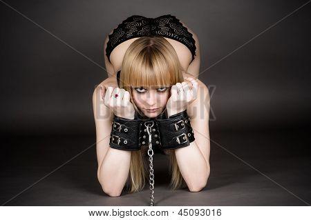 beautiful woman in handcuffs