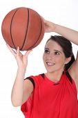 foto of netball  - Young female basketball player - JPG