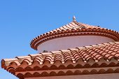 picture of red roof tile  - Small statue of an egg on the red tiled roof - JPG