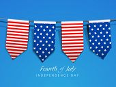 American Independence Day background with flag ribbons and  text Fourth of July.