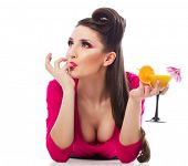 stock photo of hottie  - Sexy girl in hot pink mini dress with a cocktail glass - JPG