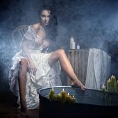 stock photo of sauna woman  - Sexy Woman Relaxing In Bath With Candels - JPG