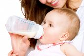 stock photo of bottles  - Feeding Baby - JPG