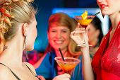 stock photo of bachelor party  - Young women in club or bar drinking cocktails and having fun - JPG