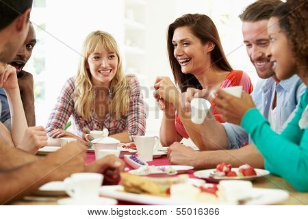 Group Of Friends Having Cheese And Coffee Dinner Party
