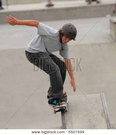 Skateboarder Grinding Rail