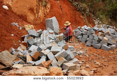 Worker Split Stone For Road-works