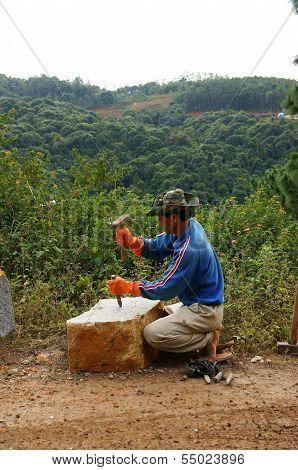 Worker Split Large Rock  By Hammer And Splitter