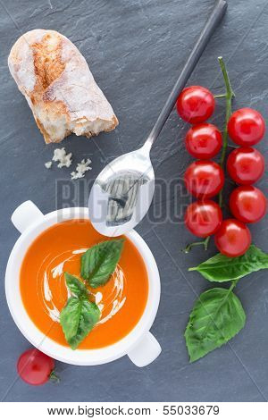 Overhead view of a bowl of tomato soup