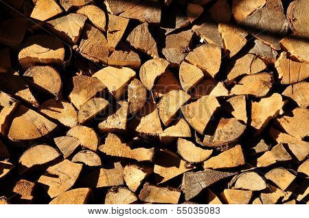 Background of stacked chopped wood prepared for winter