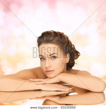 bride, health and beauty concept - dreaming woman with updo and mirror