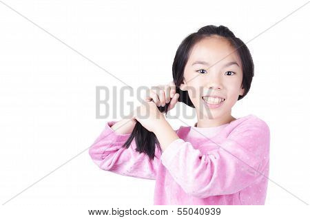 Young girl grab her hair on white background