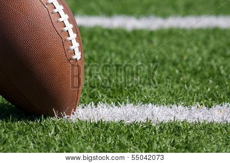 Pro American Football on the Field Close Up with Yard Lines Beyond