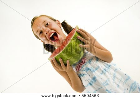 Young Girl Eating A Watermelon