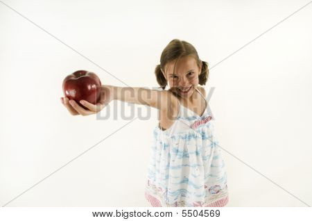 Young Girl Giving An Apple