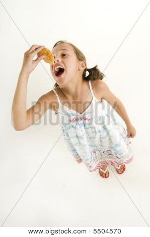Young Girl Eating A Chicken Finger