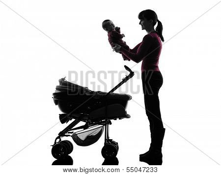 one caucasian woman prams holding baby silhouette on white background