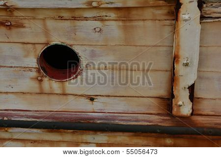 port hole in wooden boat
