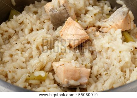 Salmon risotto cooking in a saucepan