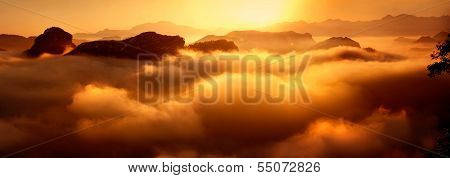 Sea of clouds, rosy clouds and mountains by sunrise