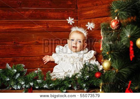 Cute Little Girl Dressed As Snowflakes