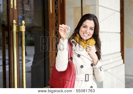 Woman Leaving Home And Holding Keys