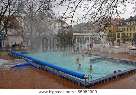 People Have A Thermal Bath In The Gellert Spa In Budapest
