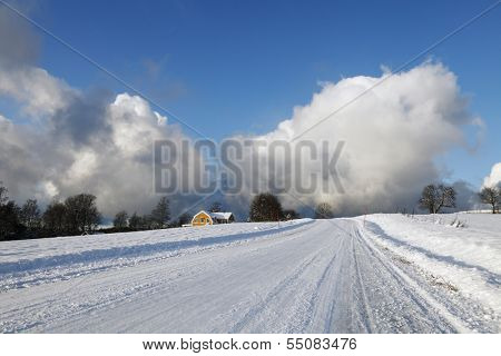 winter scenery, snowy road with giant snow clouds touching the ground, sweden