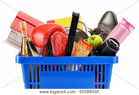Variety Of Consumer Products In Plastic Shopping Basket Isolated
