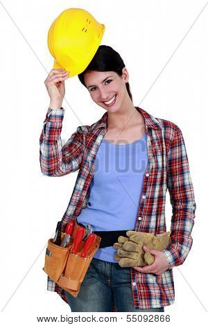 Tradeswoman putting on her hard hat