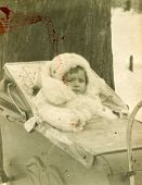 WARSAW, POLAND, CIRCA 1935 - Vintage photo of baby girl in pram, Warsaw, Poland, circa 1935