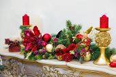 foto of mantle  - Fireplace mantle decorated with candles and garlands for Christmas - JPG