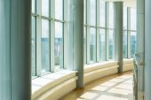 foto of business-office  - Image of corridor in office building with big windows passing daylight - JPG