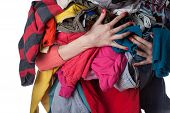 pic of dirty-laundry  - Woman holding a huge pile of clothes - JPG