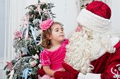image of saint-nicolas  - little girl talks to Saint Nicolas  horizontal photo - JPG