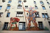 stock photo of bavaria  - David and Goliath fresco on medieval house wall  - JPG
