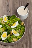 stock photo of romaine lettuce  - Caesar salad with eggs, lettuce, croutons and parmesan